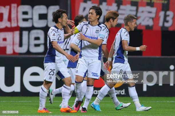 Jungo Fujimoto of Gamba Osaka celebrates scoring the opening goal with his team mate Yasuhito Endo during the JLeague J1 match between Consadole...