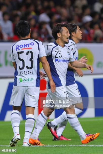 Jungo Fujimoto of Gamba Osaka celebrates scoring the opening goal with his team mate Shuhei Akasaki during the JLeague J1 match between Consadole...