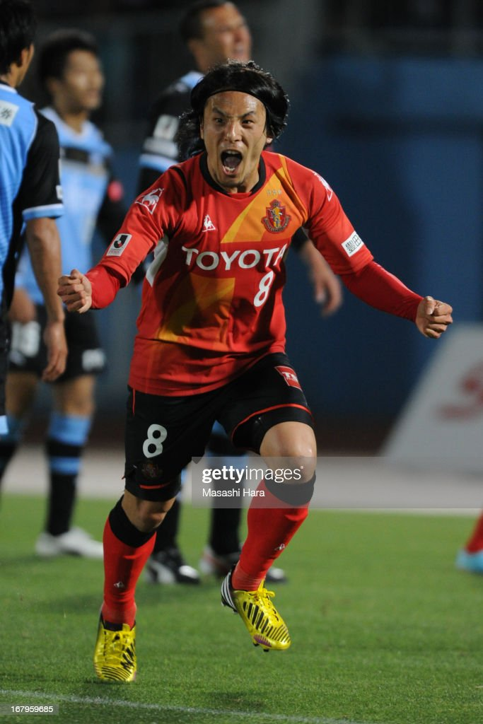 Jungo Fujimoto #8 of Nagoya Grampus celebrates his team's first goal during the J.League match between Kawasaki Frontale and Nagoya Grampus at Todoroki Stadium on May 3, 2013 in Kawasaki, Kanagawa, Japan.