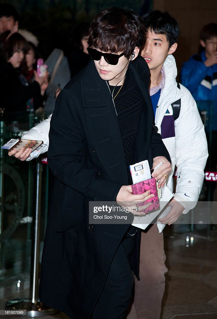Jun-Ho of <a gi-track='captionPersonalityLinkClicked' href=/galleries/search?phrase=2pm&family=editorial&specificpeople=6362819 ng-click='$event.stopPropagation()'>2pm</a> is seen at Gimpo International Airport on February 11, 2013 in Seoul, South Korea.