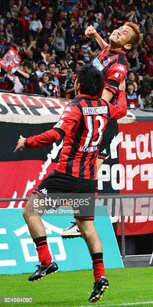 Junichi Inamoto of Consadole Sapporo celebrates scoring his team's first goal with his team mate Yoshihiro Nishimura during the JLeague second...