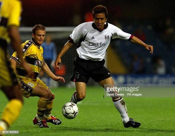 Junichi Inamoto of Fulham gets past Fabien Boudarne of Sochaux during Fulham's 10 victory in tonights Intertoto Cup Semi Final 1st Leg at Loftus Road...