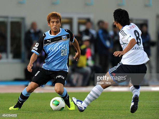 Junichi Inamoto of Kawasaki Frontale and Kosuke Nakamachi of Yokohama FMarinos compete for the ball during the JLeague match between Kawasaki...