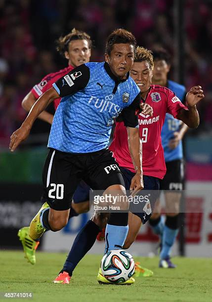 Junichi Inamoto of Kawasaki Frontale and Ryo Nagai of Cerezo Osaka compete for the ball during the JLeague match between Kawasaki Frontale and Cerezo...