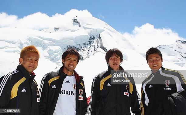 Junichi Inamoto Yoshikatsu Kawaguchi Kisho Yano and Eiji Kawashima pose in front of Allalinhorn mountain during a visit by members of the Japan...