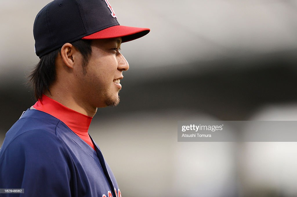 Junichi Tazawa #36 of Boston Red Sox looks on prior to the spring training game against Baltimore Orioles at Ed Smith Stadium on February 27, 2013 in Sarasota, Florida.