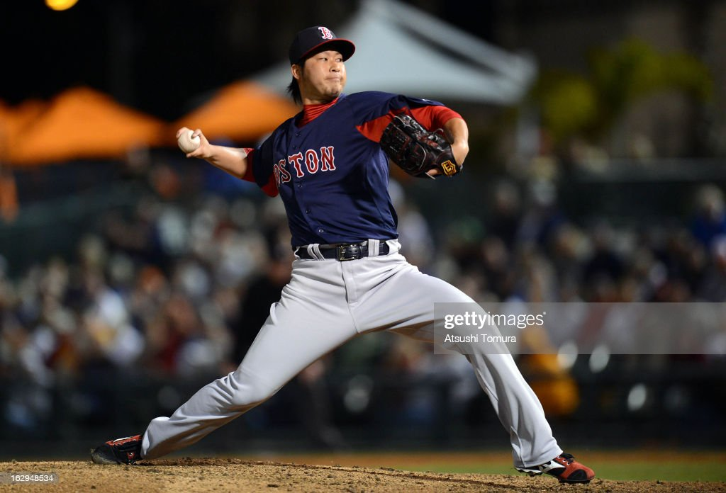 <a gi-track='captionPersonalityLinkClicked' href=/galleries/search?phrase=Junichi+Tazawa&family=editorial&specificpeople=4624306 ng-click='$event.stopPropagation()'>Junichi Tazawa</a> #36 of Boston Red Sox throws during the spring training game against Baltimore Orioles at Ed Smith Stadium on February 27, 2013 in Sarasota, Florida.