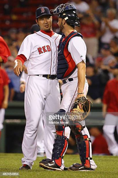 Junichi Tazawa of the Boston Red Sox and Blake Swihart celebrate at the end of the ninth inning against the Chicago White Sox at Fenway Park on July...