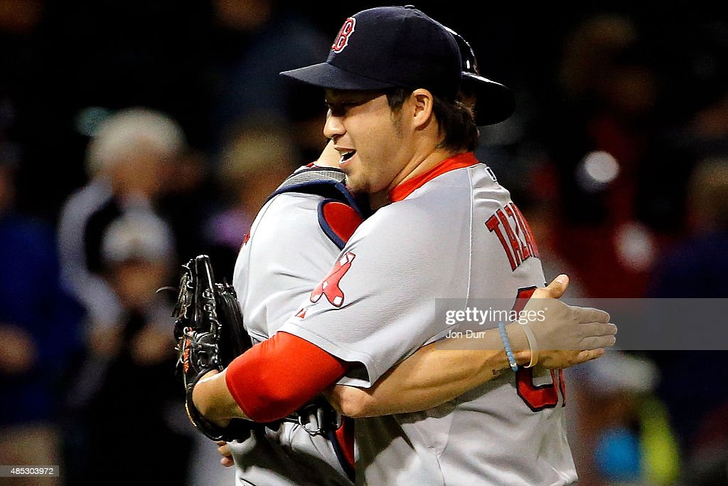 Junichi Tazawa #36 of the Boston Red Sox (R) and Blake Swihart #23 celebrate their win over the Chicago White Sox at U.S. Cellular Field on August 26, 2015 in Chicago, Illinois. The Boston Red Sox won 3-0.