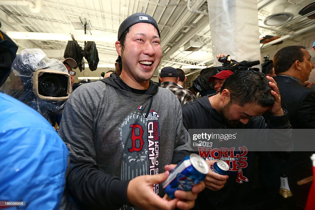<a gi-track='captionPersonalityLinkClicked' href=/galleries/search?phrase=Junichi+Tazawa&family=editorial&specificpeople=4624306 ng-click='$event.stopPropagation()'>Junichi Tazawa</a> #36 of the Boston Red Sox celebrates in the locker room after defeating the St. Louis Cardinals 6-1 in Game Six of the 2013 World Series at Fenway Park on October 30, 2013 in Boston, Massachusetts.