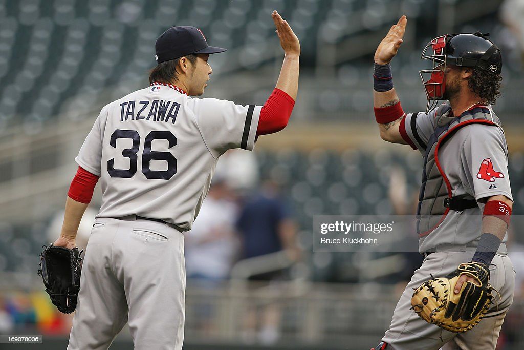 <a gi-track='captionPersonalityLinkClicked' href=/galleries/search?phrase=Junichi+Tazawa&family=editorial&specificpeople=4624306 ng-click='$event.stopPropagation()'>Junichi Tazawa</a> #36 of the Boston Red Sox celebrates with <a gi-track='captionPersonalityLinkClicked' href=/galleries/search?phrase=Jarrod+Saltalamacchia&family=editorial&specificpeople=836404 ng-click='$event.stopPropagation()'>Jarrod Saltalamacchia</a> #39 the win over the Minnesota Twins on May 19, 2012 at Target Field in Minneapolis, Minnesota. The Red Sox win 5-1.