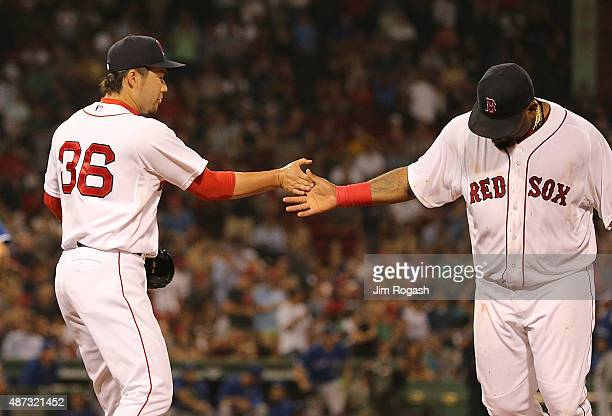 Junichi Tazawa of the Boston Red Sox celebrates with Pablo Sandoval after a scoreless inning against the Toronto Blue Jay at Fenway Park on September...