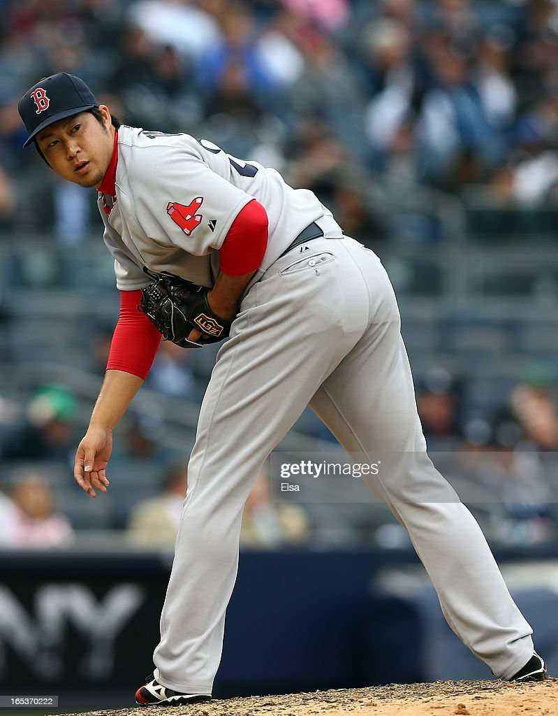 Junichi Tazawa #36 of the Boston Red Sox checks first base against the New York Yankees during Opening Day on April 1, 2013 at Yankee Stadium in the Bronx borough of New York City.