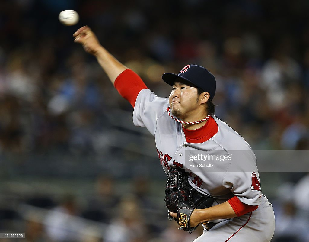 Junichi Tazawa #36 of the Boston Red Sox delivers a pitch against the New York Yankees during the eighth inning in a MLB baseball game at Yankee Stadium on September 4, 2014 in the Bronx borough of New York City.