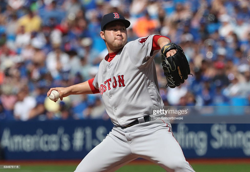 <a gi-track='captionPersonalityLinkClicked' href=/galleries/search?phrase=Junichi+Tazawa&family=editorial&specificpeople=4624306 ng-click='$event.stopPropagation()'>Junichi Tazawa</a> #36 of the Boston Red Sox delivers a pitch in the eighth inning during MLB game action against the Toronto Blue Jays on May 28, 2016 at Rogers Centre in Toronto, Ontario, Canada.