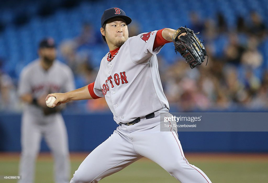 Junichi Tazawa #36 of the Boston Red Sox delivers a pitch in the seventh inning during MLB game action against the Toronto Blue Jays on August 27, 2014 at Rogers Centre in Toronto, Ontario, Canada.