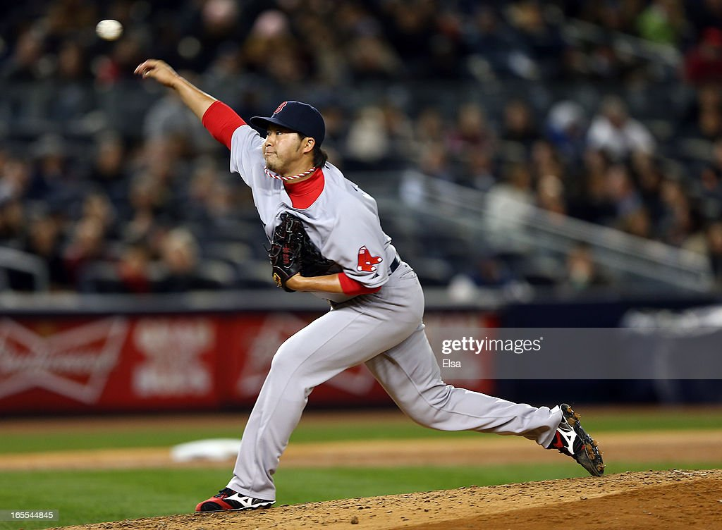 Junichi Tazawa #36 of the Boston Red Sox delivers a pitch in the sixth inning against the New York Yankees on April 4, 2013 at Yankee Stadium in the Bronx borough of New York City.