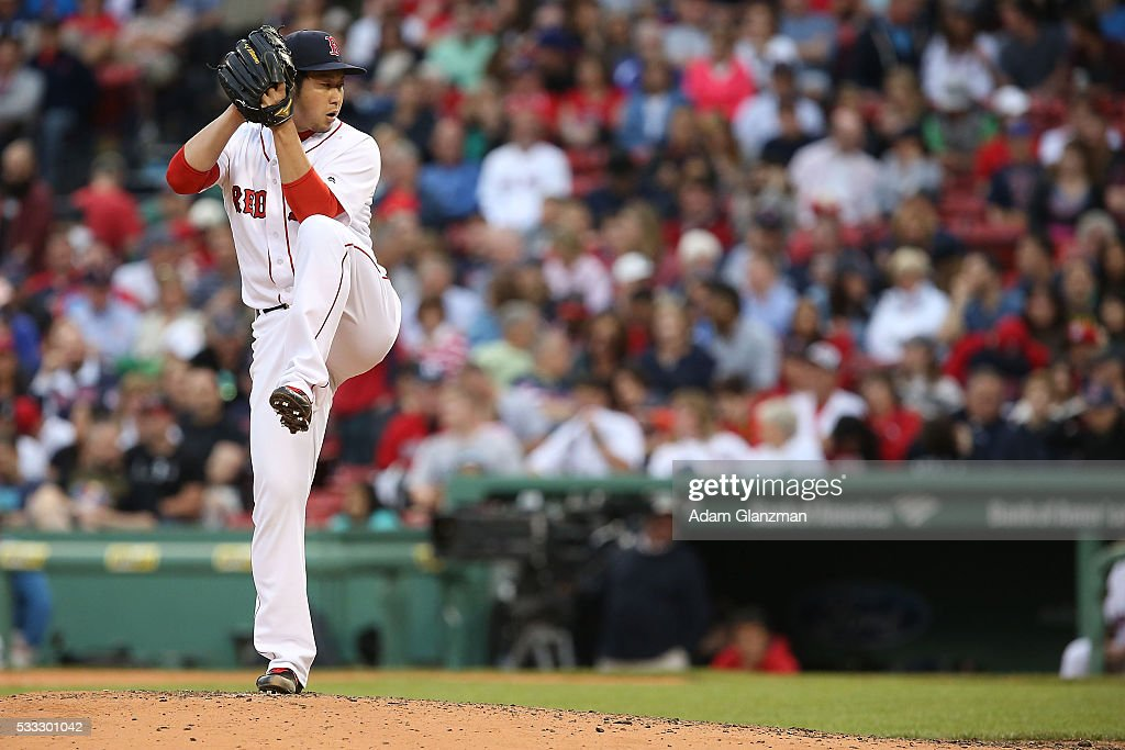 Junichi Tazawa #36 of the Boston Red Sox delivers in the eighth inning during the game against the Cleveland Indians at Fenway Park on May 21, 2016 in Boston, Massachusetts.