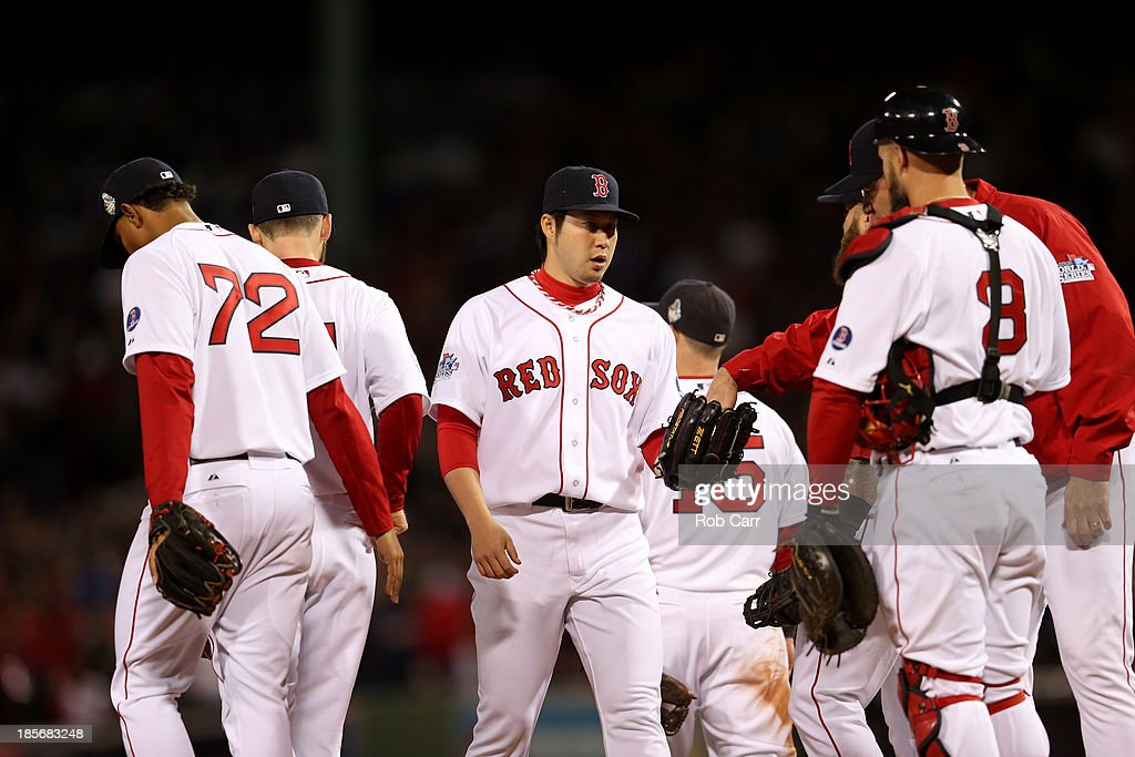 Junichi Tazawa #36 of the Boston Red Sox enters the game against the St. Louis Cardinals in the eighth inning of Game One of the 2013 World Series at Fenway Park on October 23, 2013 in Boston, Massachusetts.