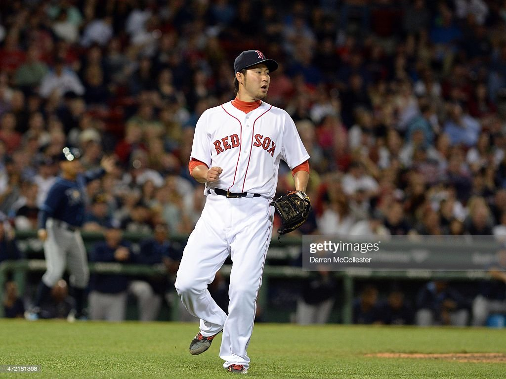 Junichi Tazawa #36 of the Boston Red Sox gives up a single in the top of the seventh inning against the Tampa Bay Rays at Fenway Park on May 4, 2015 in Boston, Massachusetts.