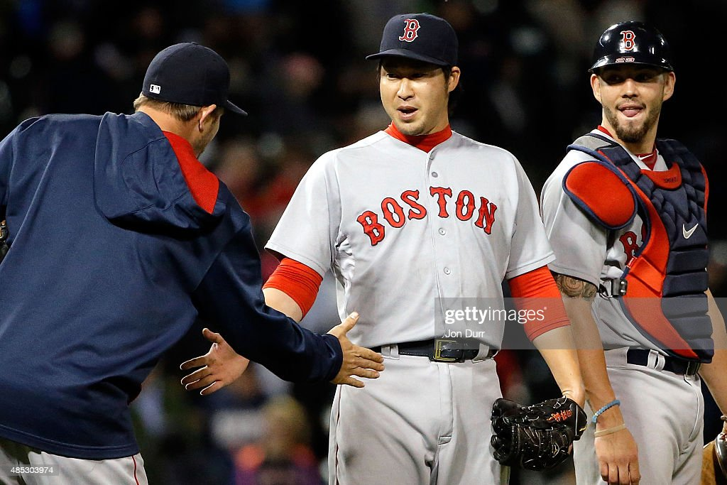 Junichi Tazawa #36 of the Boston Red Sox is congratulated by teammates after defeating the Chicago White Sox at U.S. Cellular Field on August 26, 2015 in Chicago, Illinois. The Boston Red Sox won 3-0.