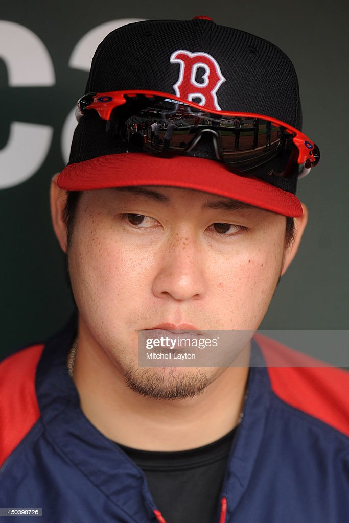Junichi Tazawa #36 of the Boston Red Sox looks on before a baseball game against the Baltimore Orioles on June 10, 2014 at Oriole Park at Camden Yards in Baltimore, Maryland.