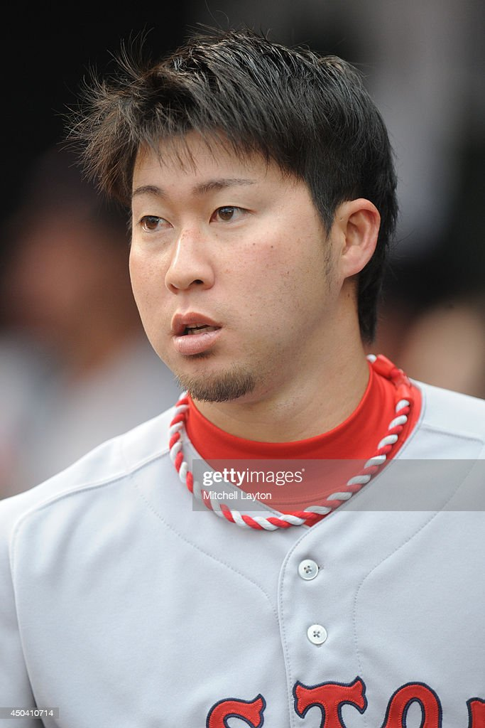 <a gi-track='captionPersonalityLinkClicked' href=/galleries/search?phrase=Junichi+Tazawa&family=editorial&specificpeople=4624306 ng-click='$event.stopPropagation()'>Junichi Tazawa</a> #36 of the Boston Red Sox looks on before a baseball game against the Baltimore Orioles on June 10, 2014 at Oriole Park at Camden Yards in Baltimore, Maryland.