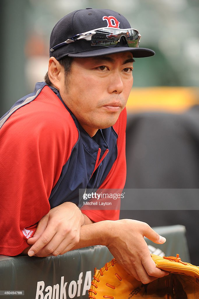 Junichi Tazawa #36 of the Boston Red Sox looks on before a baseball game against the Baltimore Orioles on June 11, 2014 at Oriole Park at Camden Yards in Baltimore, Maryland.