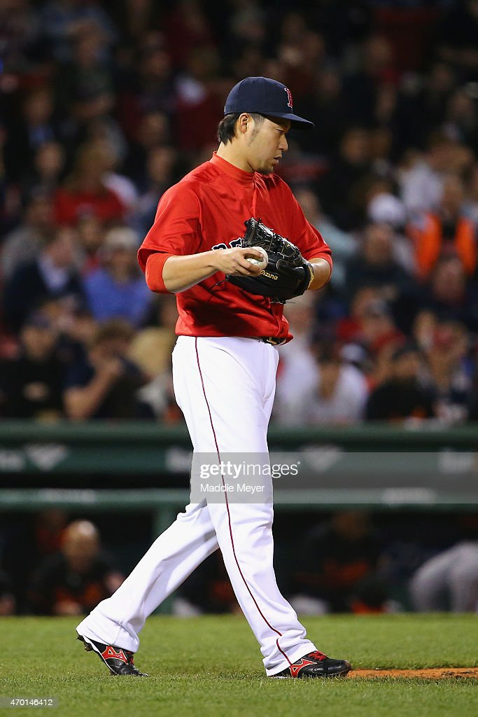 Junichi Tazawa #36 of the Boston Red Sox looks on during the eighth inning at Fenway Park on April 17, 2015 in Boston, Massachusetts.