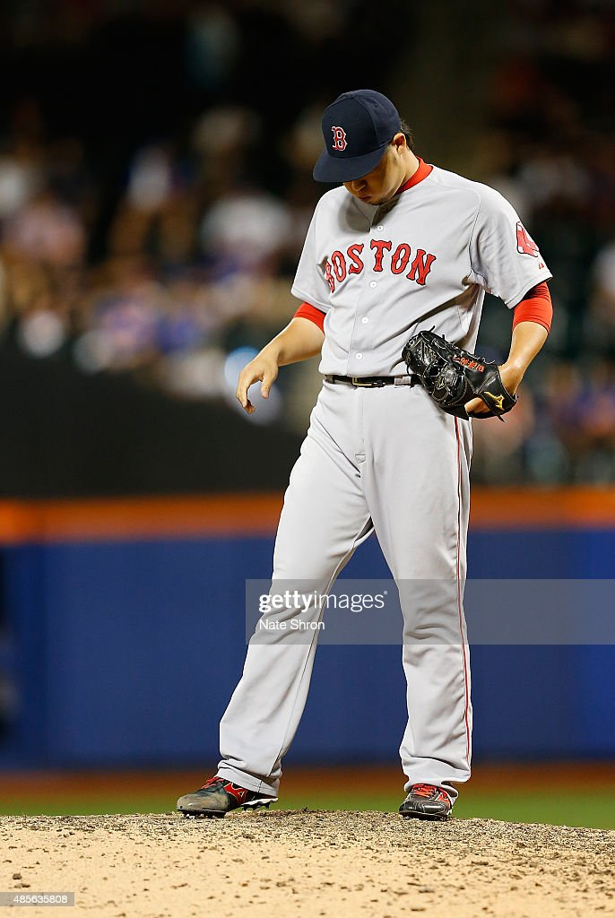 Junichi Tazawa #36 of the Boston Red Sox looks on while pitching in the tenth inning against the New York Mets on August 28, 2015 at Citi Field in the Flushing Neighborhood of the Queens borough of New York City.