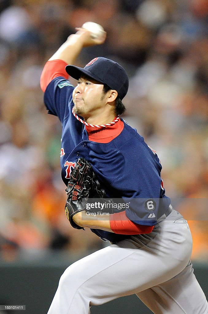 <a gi-track='captionPersonalityLinkClicked' href=/galleries/search?phrase=Junichi+Tazawa&family=editorial&specificpeople=4624306 ng-click='$event.stopPropagation()'>Junichi Tazawa</a> #63 of the Boston Red Sox pitches against the Baltimore Orioles at Oriole Park at Camden Yards on September 29, 2012 in Baltimore, Maryland.