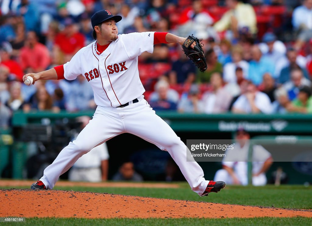 <a gi-track='captionPersonalityLinkClicked' href=/galleries/search?phrase=Junichi+Tazawa&family=editorial&specificpeople=4624306 ng-click='$event.stopPropagation()'>Junichi Tazawa</a> #36 of the Boston Red Sox pitches against the Baltimore Orioles during the game at Fenway Park on September 10, 2014 in Boston, Massachusetts.