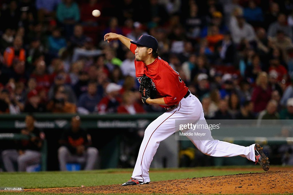 Junichi Tazawa #36 of the Boston Red Sox pitches against the Baltimore Orioles during the eighth inning at Fenway Park on April 17, 2015 in Boston, Massachusetts.
