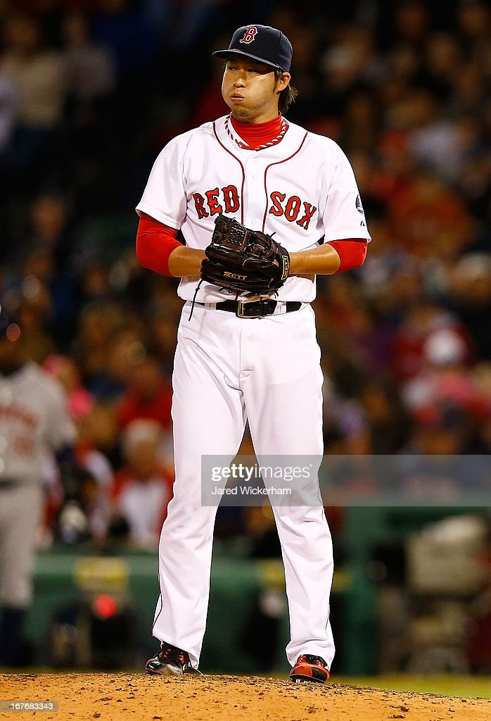 <a gi-track='captionPersonalityLinkClicked' href=/galleries/search?phrase=Junichi+Tazawa&family=editorial&specificpeople=4624306 ng-click='$event.stopPropagation()'>Junichi Tazawa</a> #36 of the Boston Red Sox pitches against the Houston Astros during the game on April 27, 2013 at Fenway Park in Boston, Massachusetts.