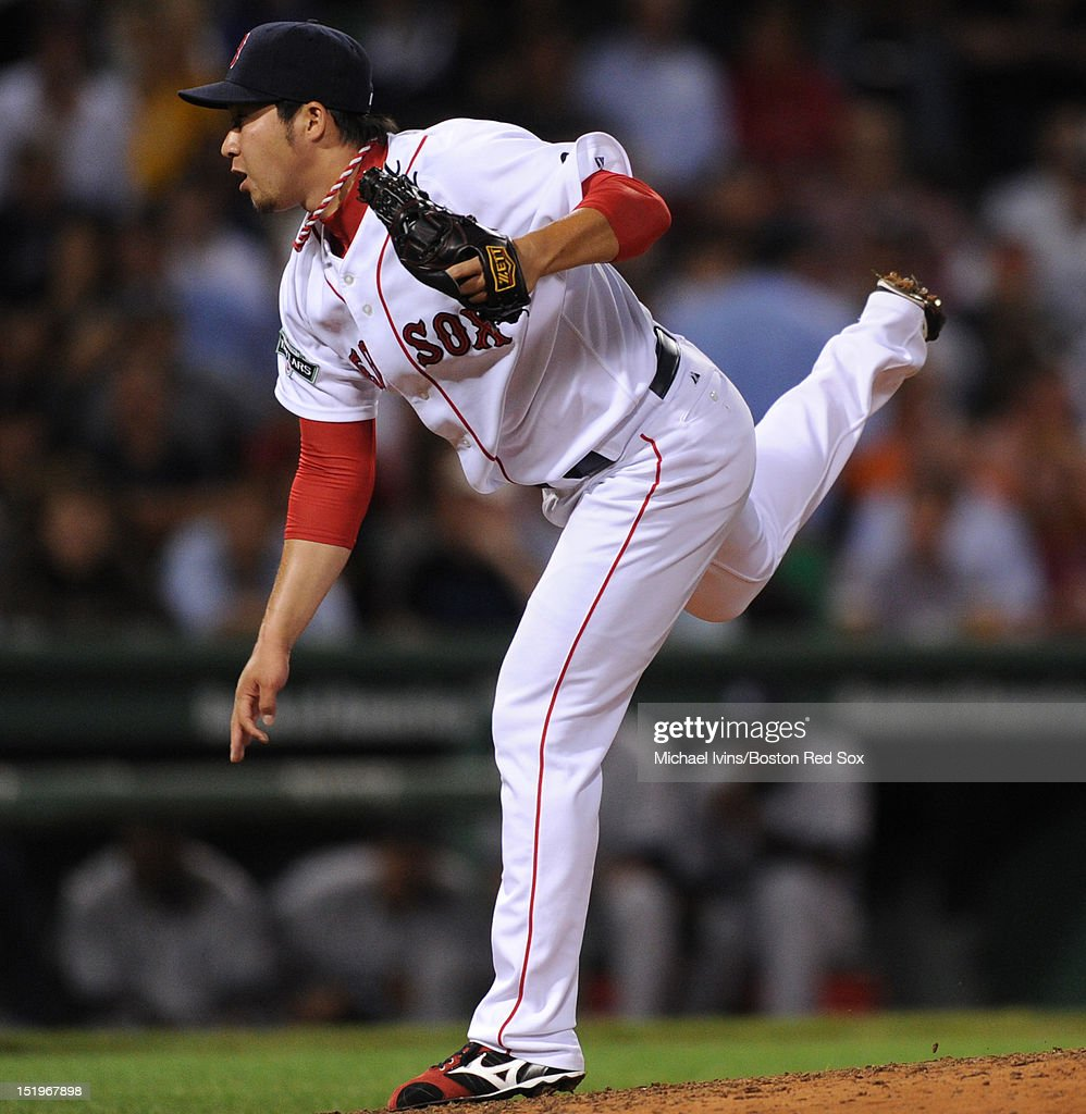 <a gi-track='captionPersonalityLinkClicked' href=/galleries/search?phrase=Junichi+Tazawa&family=editorial&specificpeople=4624306 ng-click='$event.stopPropagation()'>Junichi Tazawa</a> #63 of the Boston Red Sox pitches against the New York Yankees in the seventh inning on September 13, 2012 at Fenway Park in Boston, Massachusetts.