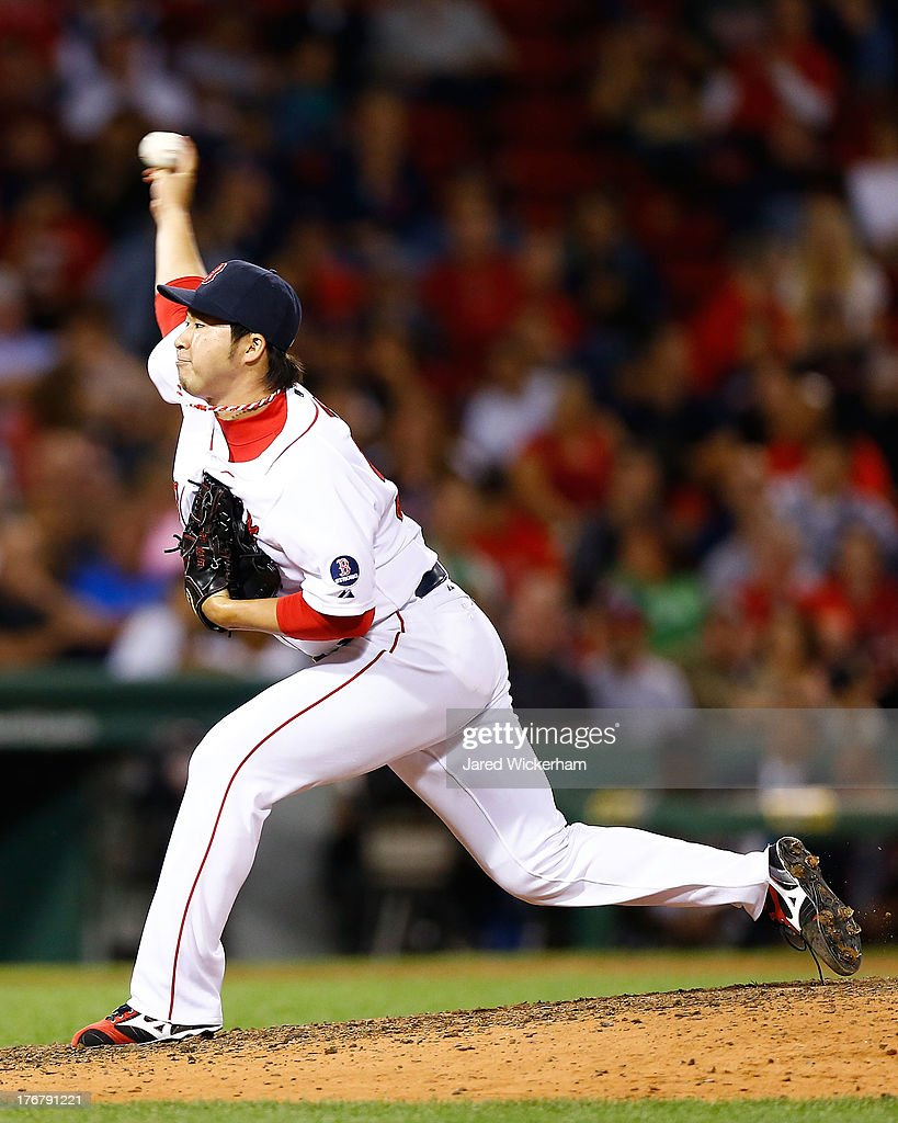 <a gi-track='captionPersonalityLinkClicked' href=/galleries/search?phrase=Junichi+Tazawa&family=editorial&specificpeople=4624306 ng-click='$event.stopPropagation()'>Junichi Tazawa</a> #36 of the Boston Red Sox pitches against the New York Yankees during the game on August 18, 2013 at Fenway Park in Boston, Massachusetts.