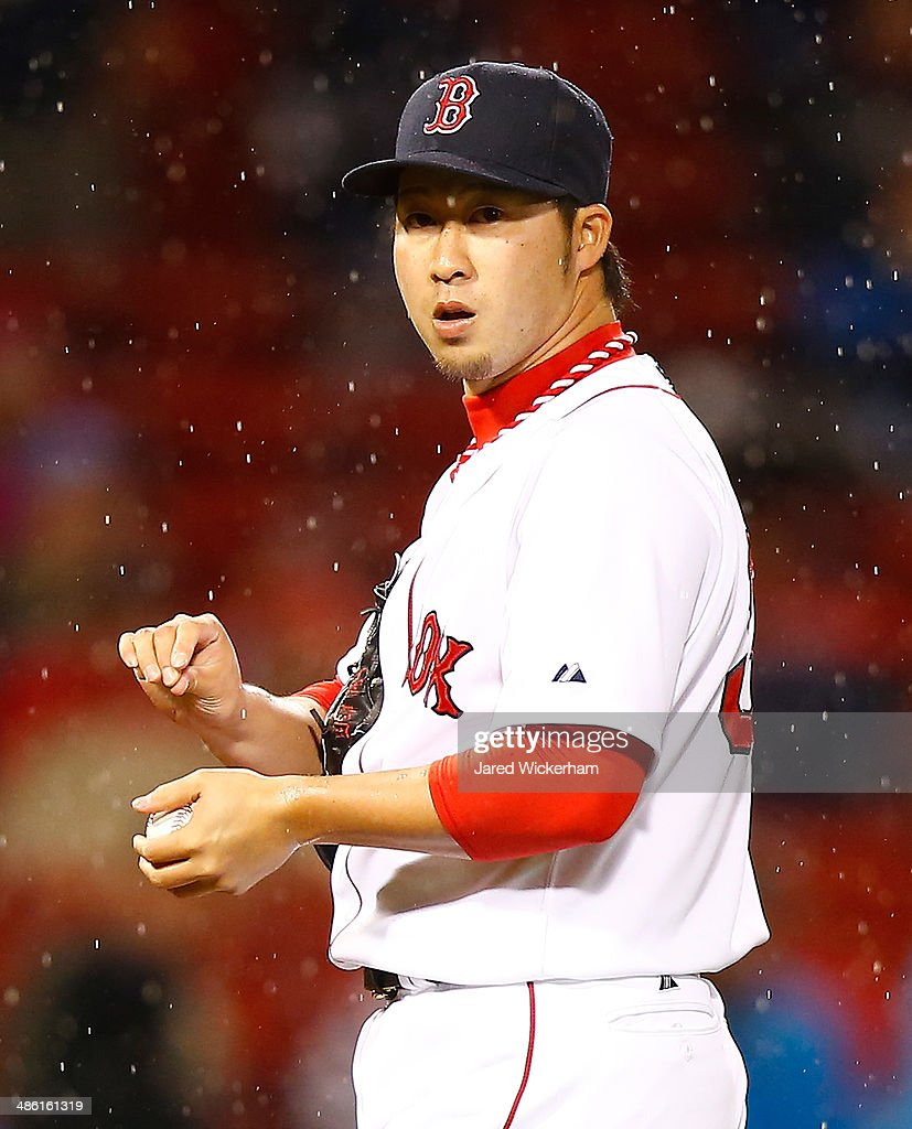 Junichi Tazawa #36 of the Boston Red Sox pitches against the New York Yankees during the game at Fenway Park on April 22, 2014 in Boston, Massachusetts.