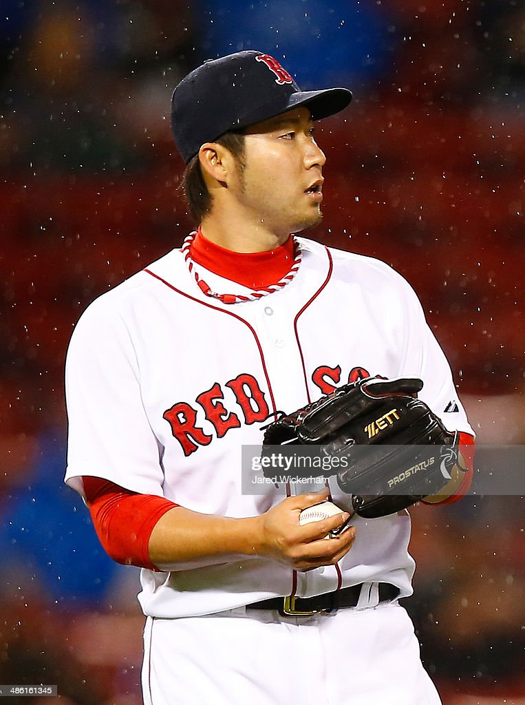 <a gi-track='captionPersonalityLinkClicked' href=/galleries/search?phrase=Junichi+Tazawa&family=editorial&specificpeople=4624306 ng-click='$event.stopPropagation()'>Junichi Tazawa</a> #36 of the Boston Red Sox pitches against the New York Yankees during the game at Fenway Park on April 22, 2014 in Boston, Massachusetts.