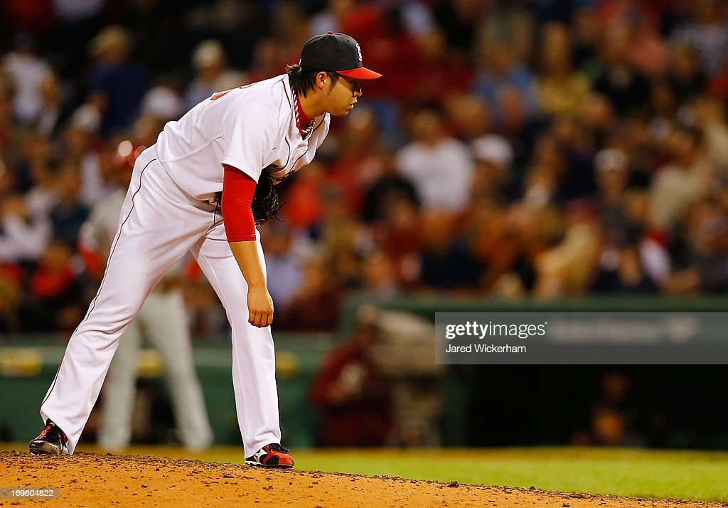<a gi-track='captionPersonalityLinkClicked' href=/galleries/search?phrase=Junichi+Tazawa&family=editorial&specificpeople=4624306 ng-click='$event.stopPropagation()'>Junichi Tazawa</a> #36 of the Boston Red Sox pitches against the Philadelphia Phillies during the interleague game on May 28, 2013 at Fenway Park in Boston, Massachusetts.