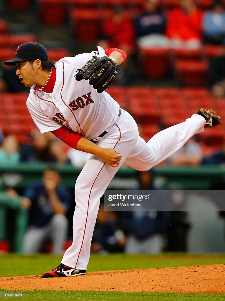 <a gi-track='captionPersonalityLinkClicked' href=/galleries/search?phrase=Junichi+Tazawa&family=editorial&specificpeople=4624306 ng-click='$event.stopPropagation()'>Junichi Tazawa</a> #36 of the Boston Red Sox pitches against the Tampa Bay Rays during the game on June 18, 2013 at Fenway Park in Boston, Massachusetts.