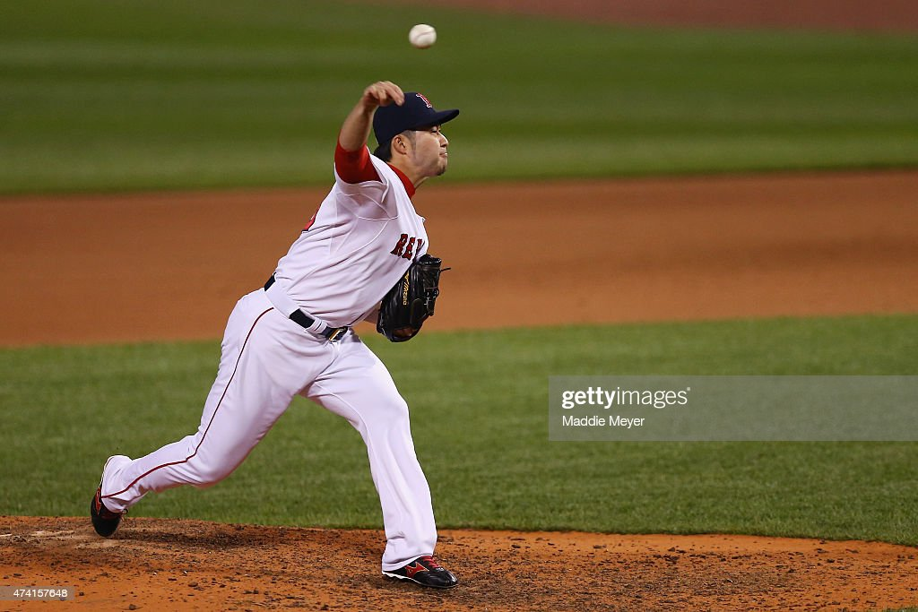 Junichi Tazawa #36 of the Boston Red Sox pitches against the Texas Rangers during the eighth inning at Fenway Park on May 20, 2015 in Boston, Massachusetts. The Rangers defeat the Red Sox 2-1.