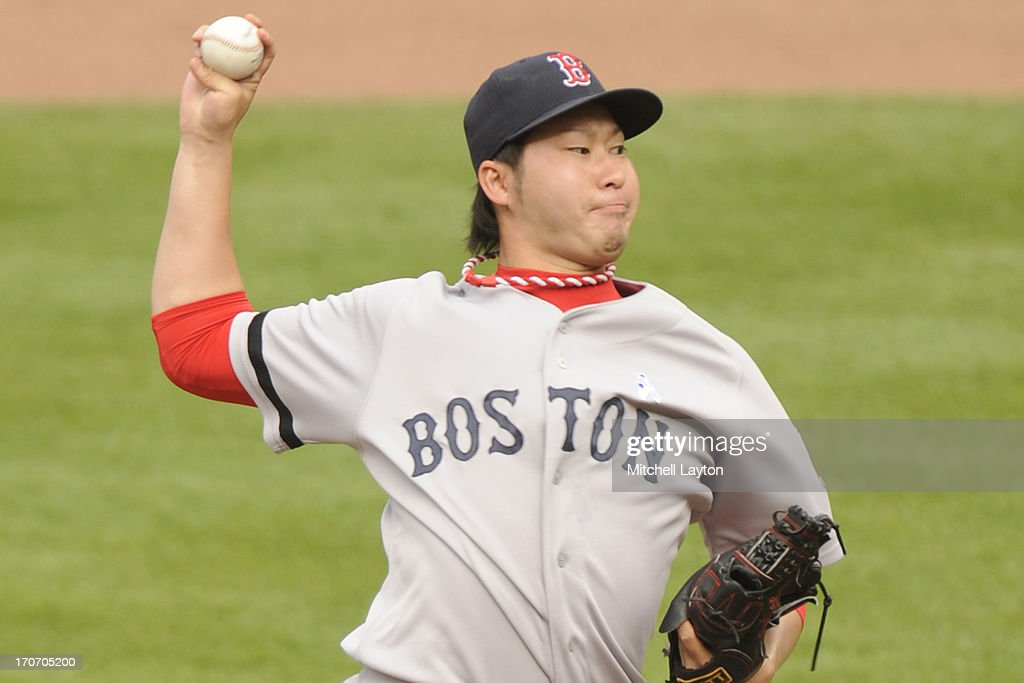<a gi-track='captionPersonalityLinkClicked' href=/galleries/search?phrase=Junichi+Tazawa&family=editorial&specificpeople=4624306 ng-click='$event.stopPropagation()'>Junichi Tazawa</a> #36 of the Boston Red Sox pitches during a baseball game against the Baltimore Orioles on June 16, 2013 at Oriole Park at Camden Yards in Baltimore, Maryland.