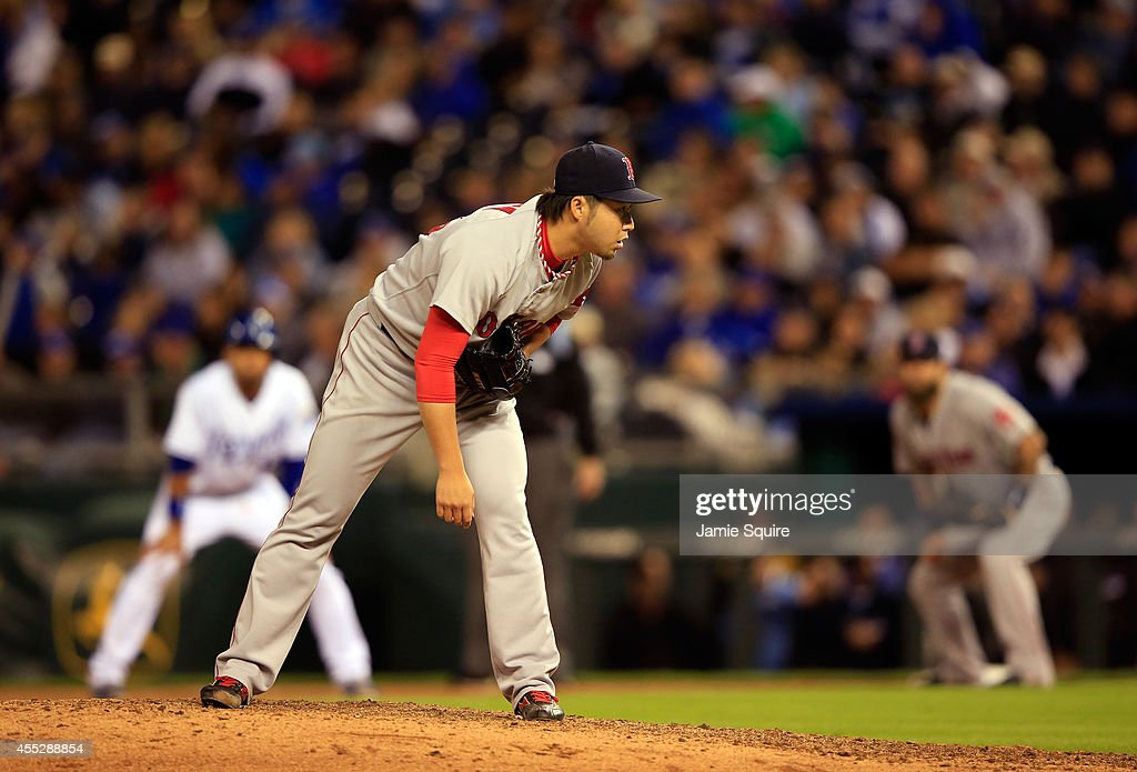 <a gi-track='captionPersonalityLinkClicked' href=/galleries/search?phrase=Junichi+Tazawa&family=editorial&specificpeople=4624306 ng-click='$event.stopPropagation()'>Junichi Tazawa</a> #36 of the Boston Red Sox pitches during the 7th inning of the game against the Kansas City Royals at Kauffman Stadium on September 11, 2014 in Kansas City, Missouri.