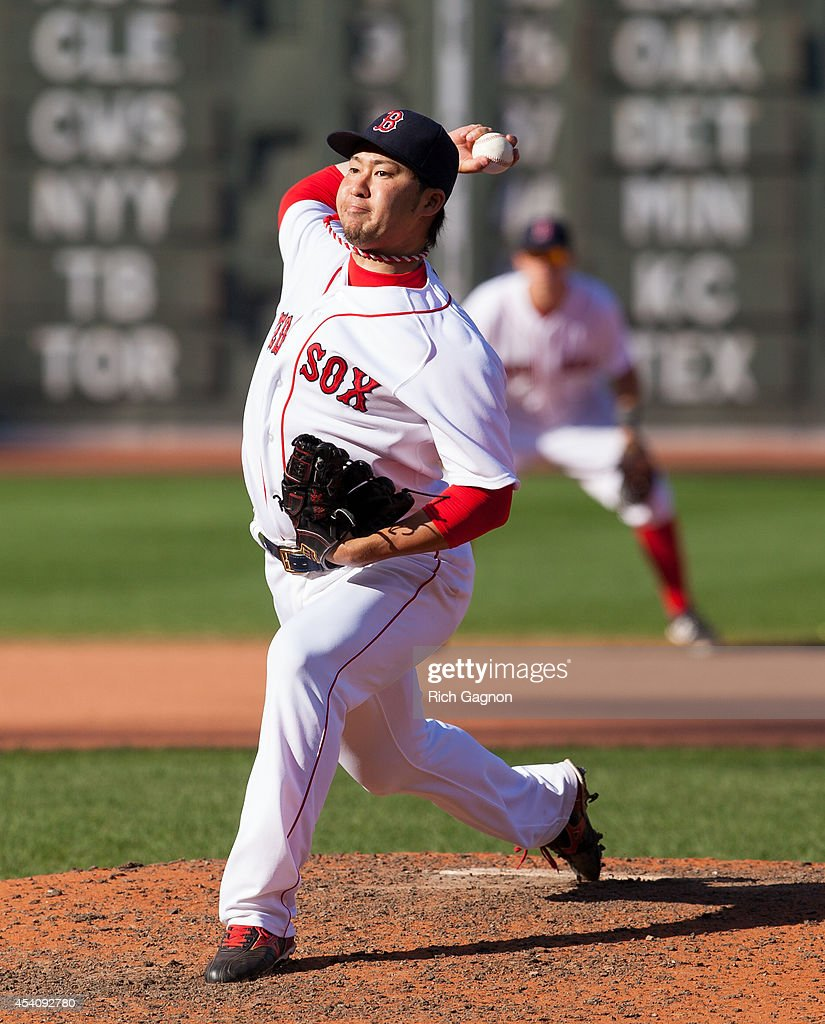 Junichi Tazawa #36 of the Boston Red Sox pitches during the eighth inning against the Seattle Mariners at Fenway Park on August 24, 2014 in Boston, Massachusetts. The Mariners won 8-6.