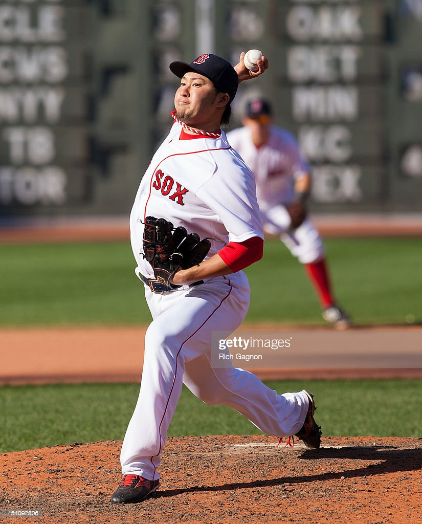 <a gi-track='captionPersonalityLinkClicked' href=/galleries/search?phrase=Junichi+Tazawa&family=editorial&specificpeople=4624306 ng-click='$event.stopPropagation()'>Junichi Tazawa</a> #36 of the Boston Red Sox pitches during the eighth inning against the Seattle Mariners at Fenway Park on August 24, 2014 in Boston, Massachusetts. The Mariners won 8-6.