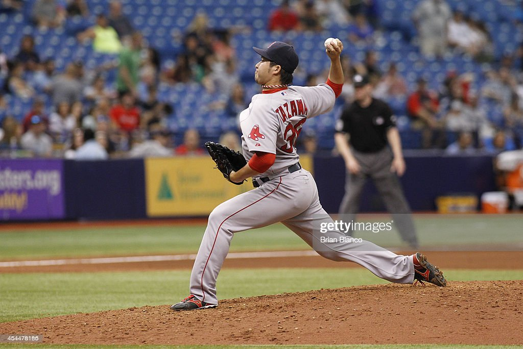 Junichi Tazawa #36 of the Boston Red Sox pitches during the seventh inning of a game against the Tampa Bay Rays on September 1, 2014 at Tropicana Field in St. Petersburg, Florida.