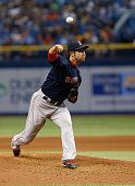 Junichi Tazawa of the Boston Red Sox pitches during the seventh inning of a game against the Tampa Bay Rays on June 26 2015 at Tropicana Field in St...