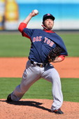 Junichi Tazawa of the Boston Red Sox pitches during the spring training game against the Pittsburgh Pirates at McKechnie Field on March 3 2014 in...