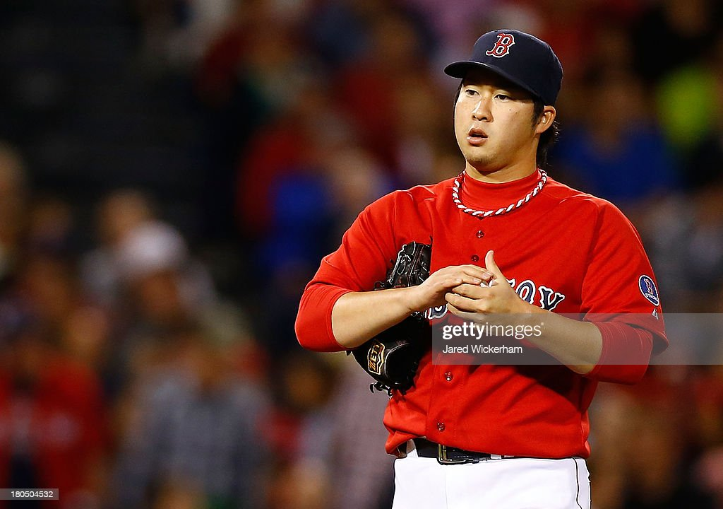 Junichi Tazawa #36 of the Boston Red Sox pitches in the 8th inning against the New York Yankees during the game on September 13, 2013 at Fenway Park in Boston, Massachusetts.