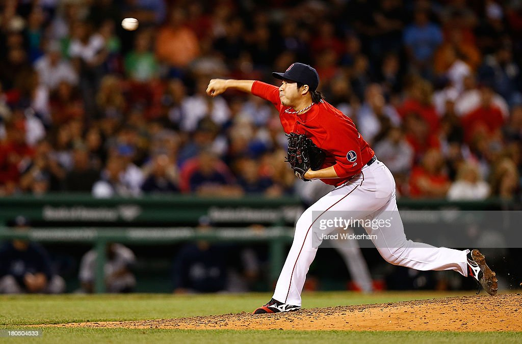 <a gi-track='captionPersonalityLinkClicked' href=/galleries/search?phrase=Junichi+Tazawa&family=editorial&specificpeople=4624306 ng-click='$event.stopPropagation()'>Junichi Tazawa</a> #36 of the Boston Red Sox pitches in the 8th inning against the New York Yankees during the game on September 13, 2013 at Fenway Park in Boston, Massachusetts.